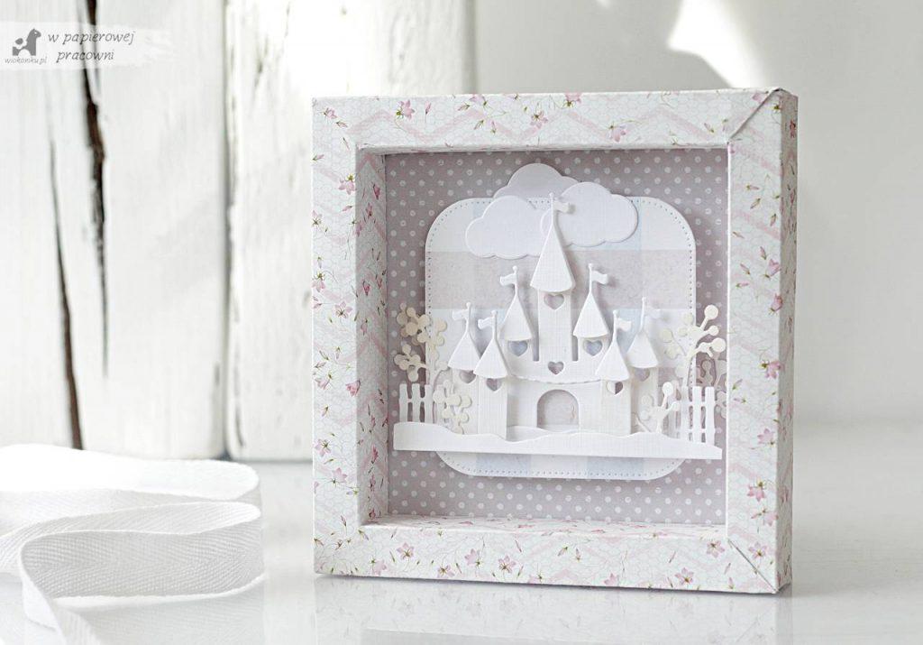 Kartka dla dziewczynki z ramką 3D, w pastelowych kolorach z białym zamkiem w centrum.