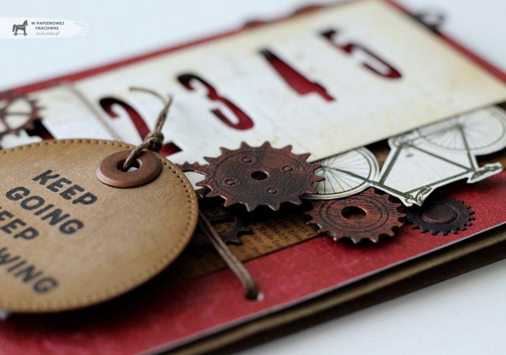 Zbliżenie na elementy kartki męskiej - tryby wykończone woskiem w kolorze miedzi